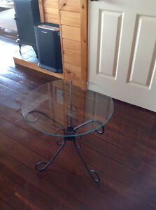 Wrought iron tables .