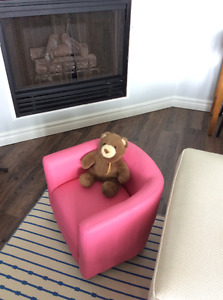Child's pink upholstered accent chair