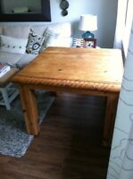 Rustic wood dining table with nautical rope carving
