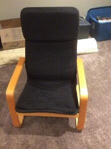 Black chair similar to ikea poang chair.