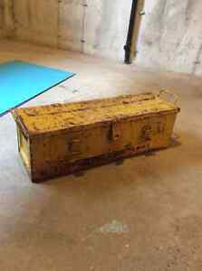 Old rusty yellow toolbox