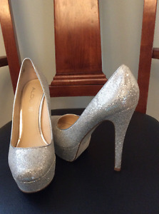 Silver shoes size 38. 7-7 1/2great for graduation and weddings