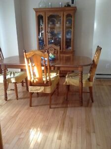 SOLID MAPLE dining room set and china cabinet.