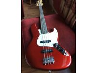 Squier by Fender Affinity Jazz Bass Guitar in red