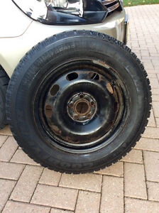 Set of 4 Goodyear Nordic snow tires on rims for sales