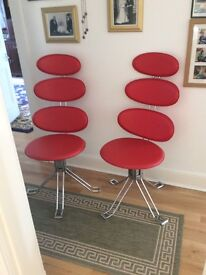 Retro cow hide retro swivel chairs on Crome stand