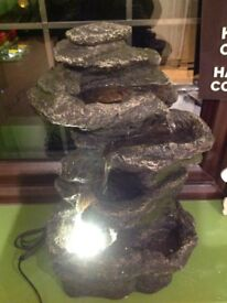Rock cascade water feature with lights