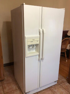 Whirlpool side by side refrigerator and freezer