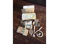 Nintendo Wii + Wii Fit Balance Board + Accessories