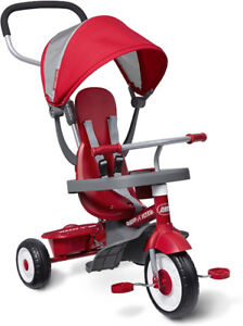 Shiny red tricycle, almost new! Fits 9months to 3years