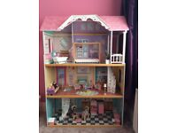 Dolls house complete with furniture and family