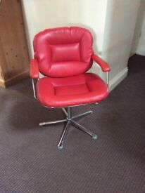 Red leather hairdressing chair
