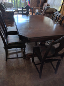 Antique dining table with 6 chairs. Leaf included (not in photo)
