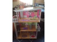 Large Dolls house (barbie size dolls). With furniture, and battery powered accessories (lights, etc)