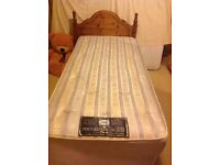 Sealy Posturepedic De Luxe Single bed with wooden headboard