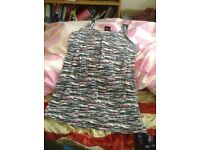 Soft, stretchy vest top in superb condition- size 10-12