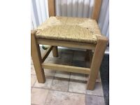 Two identical solid wood chairs