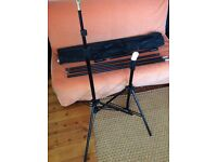 Photo studio backdrop stands and horizontal support in a bag