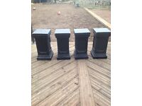 Set of four dark grey plinths