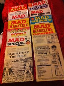 A Collection Of 12 Vintage MAD magazines.   Reading condition.