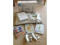 Nintendo Wii, Two Controllers, Wii Fit Board and Four Games