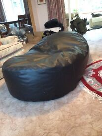 Giant black faux leather bean bag