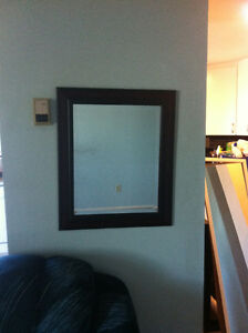 miror in dark stained wood frame