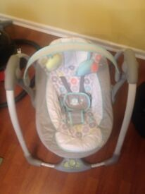 Baby electric battery powered rocker, plays tunes.
