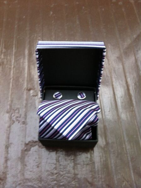 Tie and cuff links set. Never used before. Unwanted Christmas gift.