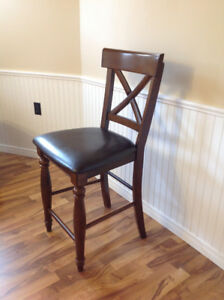 four counter height chairs in excellent condition