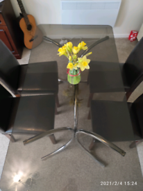 Glass table & 4 Leather chairs