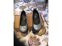 New size 3 shoes from Schuh Silver in colour.