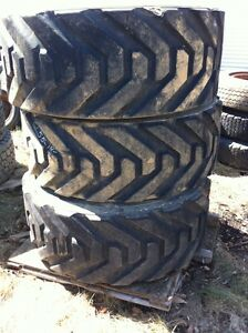 SET of FOUR outrigger 445/50d/710 equipment tires and rims