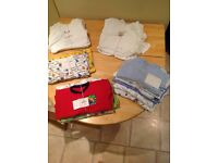 Selection of boy's bodysuits and baby grows sizes 6-12 months upwards