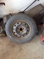 "4 x 16"" Firestone winter tires on rim"