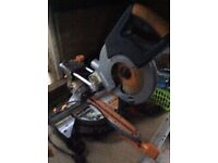 Electric bench sliding mitre saw with laser guidance