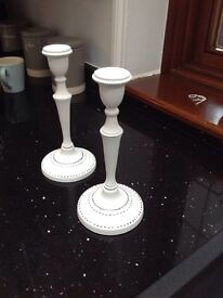 Set of two white candle holders