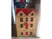 Large four storey wooden dolls house