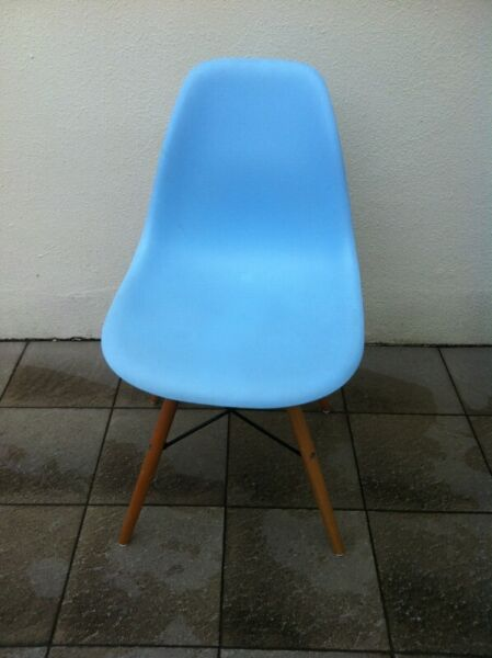 Blue plastic chair with wooden legs.   Physical condition as shown in the photos.