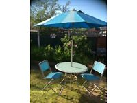 Garden table, chairs & parasol