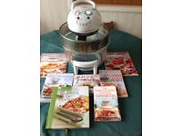 Halogen oven with accessory and lid rest with cookbooks