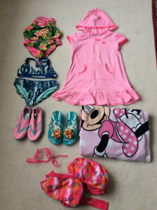 10 piece of very clean swim suit , towels, sandals, goggles 6 yr