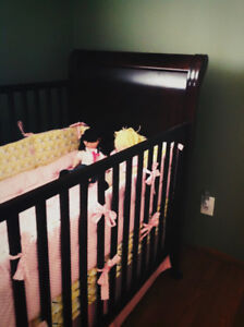 Solid wood baby crib in excellent condition