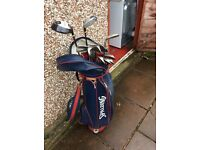 Spaulding golf bag and full set of Wilson irons.