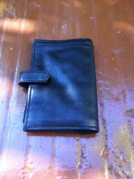 Black leather wallet. Dimension 20 x 16cm when opened and 10 x 16cm when closed.