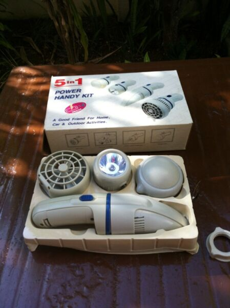 Power handy 5 in 1 kit.  Fan, Torch, Massager and Vacuum cleaner.