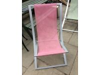 Green and pink metal deck chairs