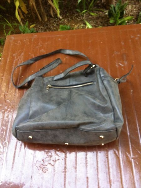 Grey handbag seldom use and in good condition. Dimension 30 x 31 x 14cm.