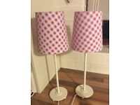 Two white Ikea table lamps with check shades.
