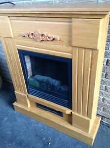 Wooden framed electric fireplace.